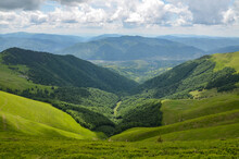 Green Fields And Mountains, Blue Sky With Clouds. Carpathian Mountains In Late Summer. Carpathians, Ukraine