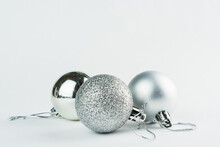 Christmas Ornament Isolated On White Background. Polka Dots To Hang On Christmas Trees To Celebrate The Arrival Of Santa Claus. Silver Ball.