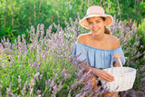 Portrait of positive woman with basket on lavender field