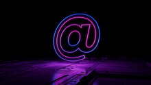 Pink And Blue Email Technology Concept With @ Symbol As A Neon Light. Vibrant Colored Icon, On A Black Background With High Tech Floor. 3D Render