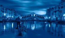 Gondola Near Rialto Bridge At Twilight Blue Hour - Venice, Italy