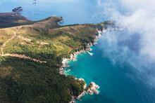 Turquoise Sea And Rocky Coastline Of Autumn Gamow Peninsula, Aerial View. The Peter The Great Gulf.