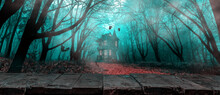 Rustic Wooden Board Table In Front Of Foggy Autumn Forest And Witch's House