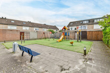 Playground In Backyard Of House
