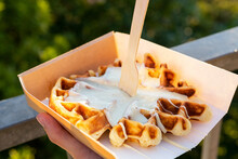 Anonymous Person Enjoying Delicious Waffles Against Mountains In Sunshine