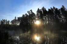 Tiveden National Park. Double Sun Visible. Early Morning At A Sunny Lake. Beautiful View. Great Nature During The Month Of September. Sweden, Scandinavia, Europe.