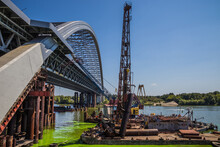 Construction Of A Large Arched Bridge In The Capital Of Ukraine. Podolsky Bridge, Panoramic View Of The Bridge Under Construction Across The Dnipro, Clear Weather, Summer. Kyiv