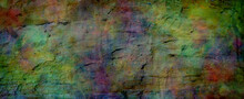 Multicoloured Grunge Rock Face Banner Background - Textured Rough Earthy Richly Deeply Coloured Wide Banner Ideal For A Grunge Background