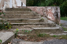 Old Cement Stairs Are Destroyed Under The Influence Of Wet Weather And Time, The Stairs Need Repair So That People Can Continue To Climb Them Comfortably