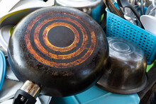 Black Soot On The Bottom Of Old Frying Pan.a Long Time Used.