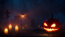 Halloween Jack O' Lantern With Candles, In A Haunted Forest Graveyard At Night.