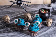 A Halloween Cupcake, Chocolate, Blue And Black Battercream And Gumdrop Eyes. Horizontal Shot And Selective Focus