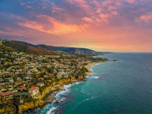 A Stunning Aerial Shot Of The Coast Of California With Waves Rolling In An Homes Along The Shoreline At Victoria Beach In Laguna Beach California USA