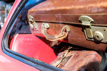 Suitcases At Trunk Of A Car.