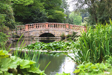 Scenic View Over A Calm Lake With A Bridge