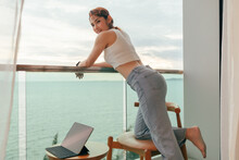 Beautiful Asian Woman Enjoy Looking The Sea View From The Balcony Of The Hotel.