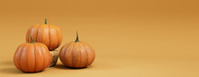 Seasonal Background Banner With Copy-space. Trio Of Pumpkins On Mid Yellow Color. Autumn Concept.