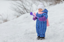 Cute Two Year Old Kid Playing With Snowballs Maker Toy. Smiling Little Girl Having Fun In Winter Park. Concept Of Care And Warm Clothing In Frosty Cold Weather, Happy Childhood, Winter Games
