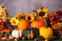 Assorted Colors Of Fall Pumpkins Sunflowers Pine Cones Nuts Corn And Butterfly