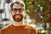 Young Caucasian Man With Beard Wearing Glasses Outdoors On A Sunny Day