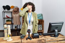 Young Middle Eastern Woman Working As Manager At Retail Boutique Smiling And Laughing With Hand On Face Covering Eyes For Surprise. Blind Concept.
