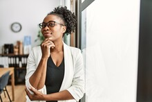 African Business Woman Working At The Office Serious Face Thinking About Question With Hand On Chin, Thoughtful About Confusing Idea