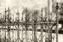 Cast Iron Cemetery Fence. Monochrome Sepia Light Selective Focus. Decorative , Blurry Bright Background