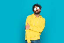 Confident Sexy Man In Yellow Hoodie With Sunglasses Posing
