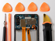 Tools For Repairing Faulty Mobile Phone. Electronic Smartphone Technology Service