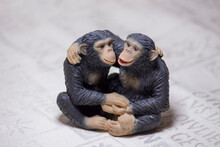 Toy Sculptures Of Monkeys On A White Background