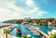 Pleasure Yachts And Boats In The Port Of Kaleici, The Historical Center Of Antalya, Turkey. Tourism And Travel, A Historical Place For Boat Trips