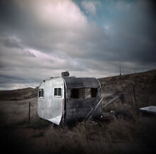 Old Derelict Caravan Sitting Abandoned In A Rural Paddock