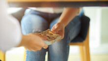 Close-up Businesswomen Hands Taking Bribe Money Under Table