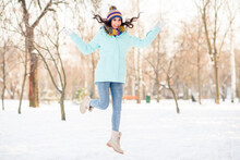 Photo Of Sporty Cute Lady Jump Wear Knitted Mittens Headwear Scarf Coat Jeans Boots In Winter Park Outdoors