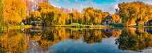 Sunny Autumn Scene Of City Park. Panoramic Morning View Of Orange Trees In Ternopil Square, Ukraine, Europe. Beauty Of Nature Concept Background.