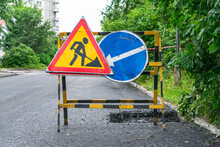 Road Signs Warning About Repair Work And Laying Of New Asphalt