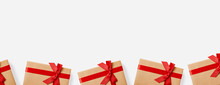 Christmas Gifts And Presents Concept Web Banner With Copy Space. Gift Boxes Wrapped In Craft Paper With Red Bow On White Background.