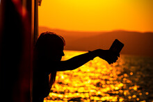 Sunset And Silhouette Of A Person