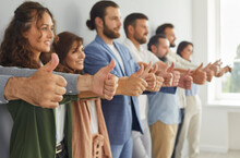 Group Of Successful Business People Doing Like Gesture All Together. Team Of Ambitious Confident Young, Mature And Senior Businesspeople Standing In Modern Office, Giving Thumbs Up And Smiling