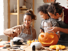 Joyful African American Family Mother, Father And Boy Son Enjoying Halloween Preparation At Home