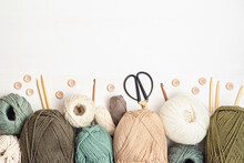 Craft Hobby Background With Yarn In Natural Colors. Recomforting, Destressing Hobby For Cold Fall And Winter Weather. Mock Up, Copy Space, Top View
