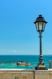 Old lamppost on a wall overlooking the sea and historic fortification in Todos os Santos Bay in Salvador, Bahia Todos os Santos Bay in Salvador, Bahia
