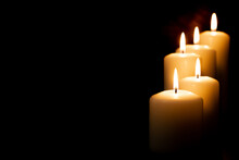 Burning Candles On Dark Background. Front View.