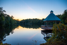 A Gazebo Looks Out Over The Calm Waters Of Mill Pond In Milton During The Late Sunset.