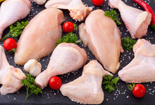 Assortment Of Raw Chicken  Breast ( Fillet ) , Wings And Legs  With Spices And Herbs