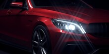 Close Up Of Red Sports Car Headlight.