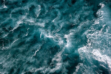 Aerial View To Seething Waves With Foam. Waves Of The Sea Meet Each Other During High Tide And Low Tide