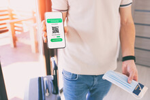 The Man Showing Digital Health Passport App In Mobile Phone For Travel.