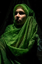 Saint Mary Cosplay In Green Draping Outdoors