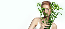 Portrait Of A Beautiful Young Woman With Red Hair And Natural Makeup. Woman Holding A Bouquet Of White Flowers.Advertising Natural Cosmetics.